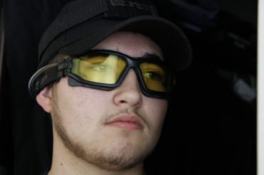 Man wearing ExFog system with hat and goggles