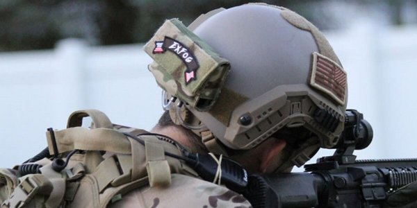 Man wearing ExFog system on military helmet